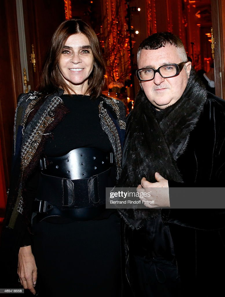 Carine Roitfeld and designer Alber Elbaz attend the Swarovski X Lanvin Cocktail Party at ShangriLa Hotel Paris on March 6 2015 in Paris France