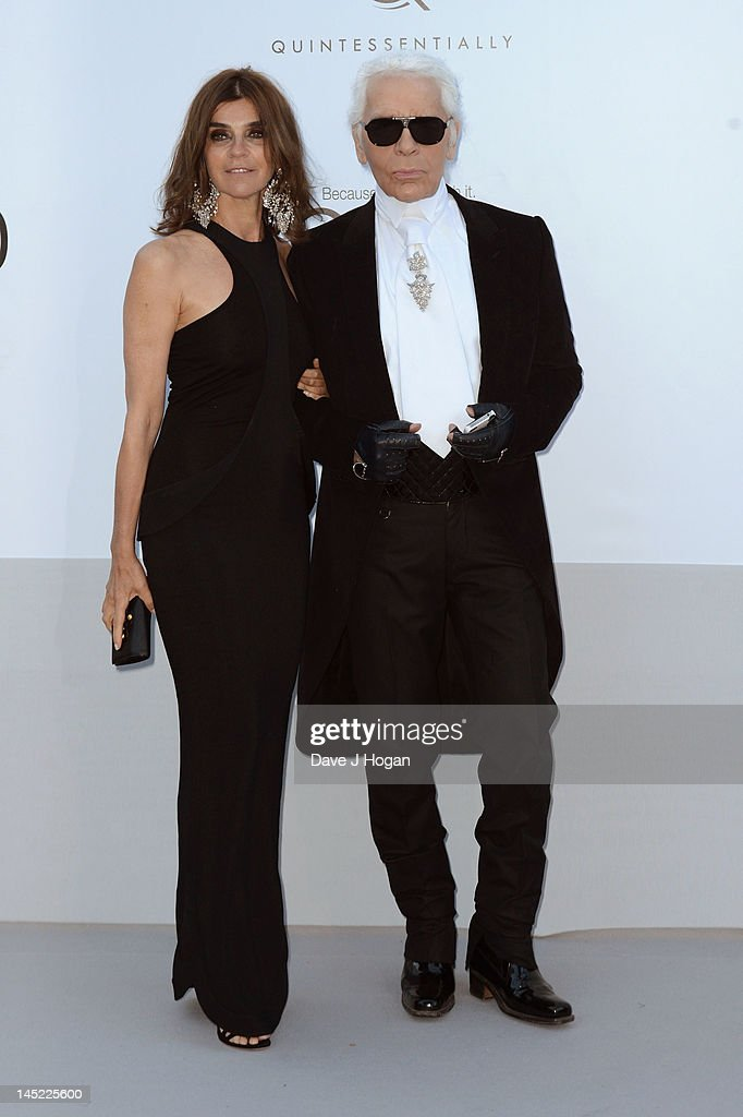 <a gi-track='captionPersonalityLinkClicked' href=/galleries/search?phrase=Carine+Roitfeld&family=editorial&specificpeople=240177 ng-click='$event.stopPropagation()'>Carine Roitfeld</a> and designer Karl Lagerfeld arrive at the 2012 amfAR's Cinema Against AIDS during the 65th Annual Cannes Film Festival at Hotel Du Cap on May 24, 2012 in Cap D'Antibes, France.