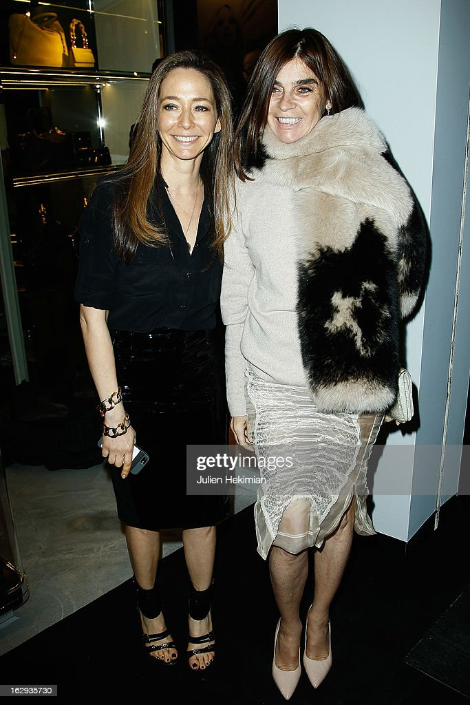 <a gi-track='captionPersonalityLinkClicked' href=/galleries/search?phrase=Carine+Roitfeld&family=editorial&specificpeople=240177 ng-click='$event.stopPropagation()'>Carine Roitfeld</a> (R) and guest attend the Tom Ford Flagship Opening Cocktail as part of Paris Fashion Week at on March 1, 2013 in Paris, France.