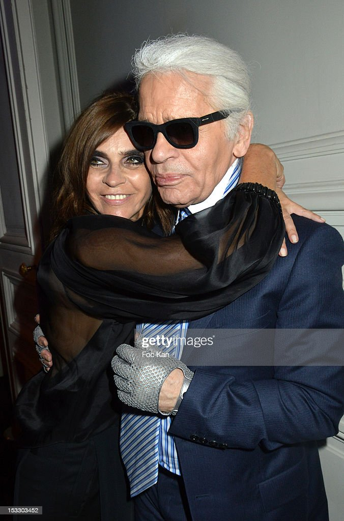 <a gi-track='captionPersonalityLinkClicked' href=/galleries/search?phrase=Carine+Roitfeld&family=editorial&specificpeople=240177 ng-click='$event.stopPropagation()'>Carine Roitfeld</a> and <a gi-track='captionPersonalityLinkClicked' href=/galleries/search?phrase=Karl+Lagerfeld+-+Fashion+Designer&family=editorial&specificpeople=4330565 ng-click='$event.stopPropagation()'>Karl Lagerfeld</a> attend LE BAL hosted by MAC and <a gi-track='captionPersonalityLinkClicked' href=/galleries/search?phrase=Carine+Roitfeld&family=editorial&specificpeople=240177 ng-click='$event.stopPropagation()'>Carine Roitfeld</a> as part of Paris Fashion Week Spring / Summer 2013 at Hotel Salomon de Rothschild on October 2, 2012 in Paris, France.