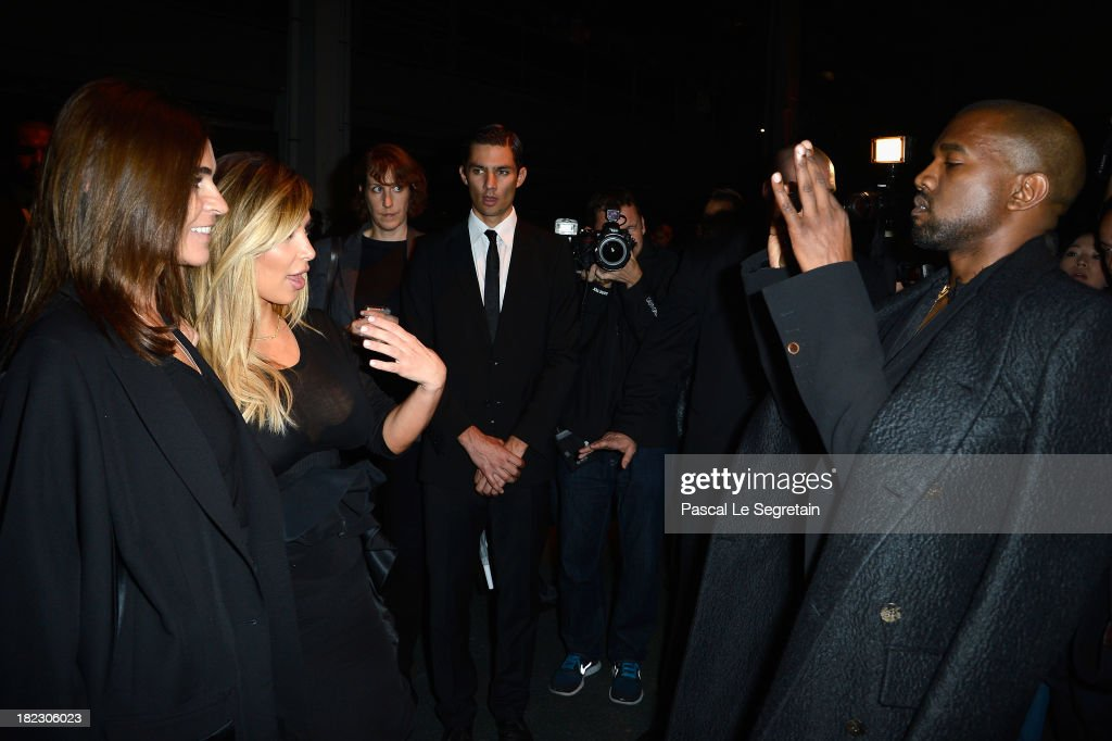 <a gi-track='captionPersonalityLinkClicked' href=/galleries/search?phrase=Carine+Roitfeld&family=editorial&specificpeople=240177 ng-click='$event.stopPropagation()'>Carine Roitfeld</a> and <a gi-track='captionPersonalityLinkClicked' href=/galleries/search?phrase=Kim+Kardashian&family=editorial&specificpeople=753387 ng-click='$event.stopPropagation()'>Kim Kardashian</a> pose for <a gi-track='captionPersonalityLinkClicked' href=/galleries/search?phrase=Kanye+West+-+Musician&family=editorial&specificpeople=201803 ng-click='$event.stopPropagation()'>Kanye West</a> as they attend the Givenchy show as part of the Paris Fashion Week Womenswear Spring/Summer 2014 on September 29, 2013 in Paris, France.