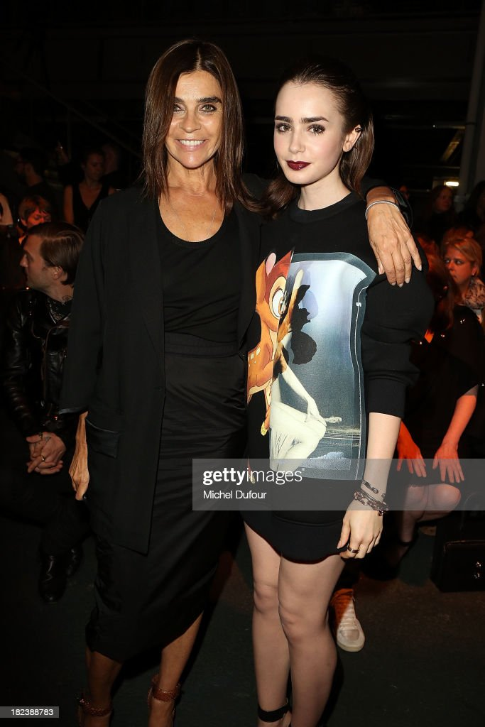 Carine Roitfeld and Lily Collins attend the Givenchy show as part of the Paris Fashion Week Womenswear Spring/Summer 2014 on September 29, 2013 in Paris, France.