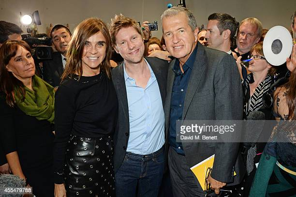 Carine Roitfeld Christopher Bailey and Mario Testino pose backstage at the Burberry Womenswear SS15 show during London Fashion week at Kensington...