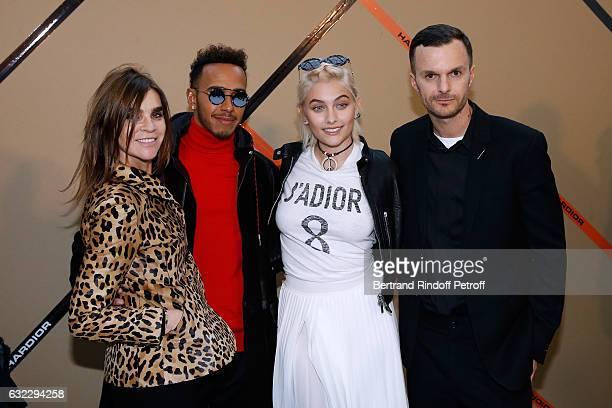 Carine Roitfeld Formula One driver Lewis Hamilton Paris Jackson and Stylist Kris Van Assche pose backstage after the Dior Homme Menswear Fall/Winter...