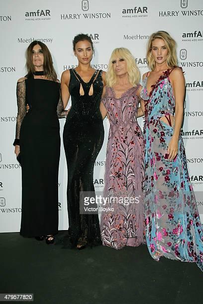 Carine Roitfeld Irina Shayk Donatella Versace and Rosie HuntingtonWhiteley attend the amfAR dinner at the Pavillon LeDoyen during the Paris Fashion...