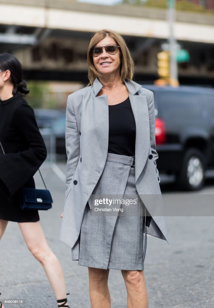 Carine Roitfeld wearing grey blazer jacket and skirt seen in the streets of Manhattan outside Coach during New York Fashion Week on September 12, 2017 in New York City.