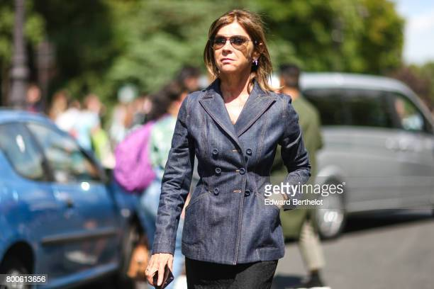 Carine Roitfeld wears sunglasses a blazer jacket a tweed skirt and yellow shoes outside the Dior show during Paris Fashion Week Menswear...