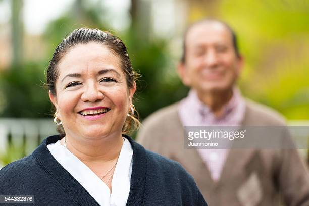 Caring, hispanic nurse and elderly senior patient in nursing home