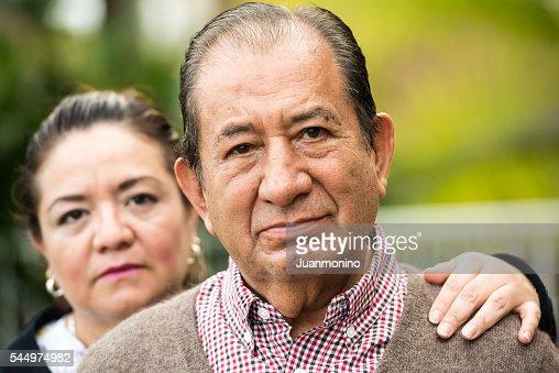 Caring, hispanic nurse and elderly senior patient in nursing home