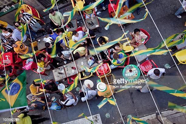 Cariocas inhabitants of Rio de Janeiro celebrate in the streets of Acros du Teles after the Brazil Portugal encounter on June 25 2010 in Rio de...