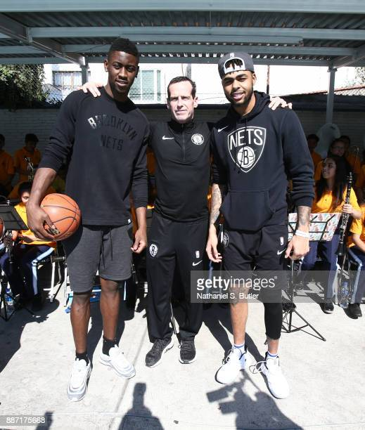 Caris Levert Head Coach Kenny Atkinson and D'Angelo Russell of the Brooklyn Nets participates during a NBA Cares School refurbishment as part of the...