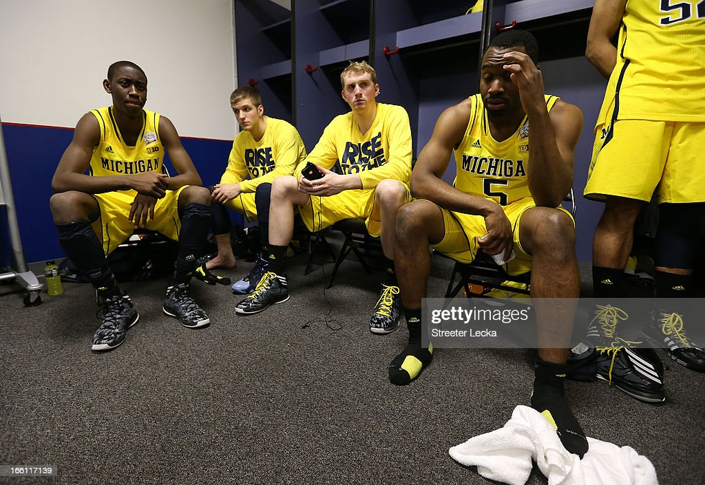 Caris LeVert #23, Max Bielfeldt #44, Blake McLimans #22 and Eso Akunne #5 of the Michigan Wolverines sit in the locker room dejected after they lost 82-76 against the Louisville Cardinals during the 2013 NCAA Men's Final Four Championship at the Georgia Dome on April 8, 2013 in Atlanta, Georgia.