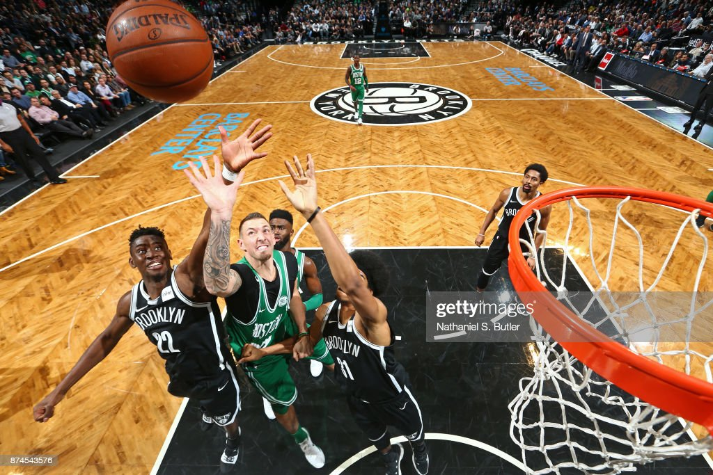 Caris LeVert #22 of the Brooklyn Nets and Daniel Theis #27 of the Boston Celtics go up for a rebound on November 14, 2017 at Barclays Center in Brooklyn, New York.