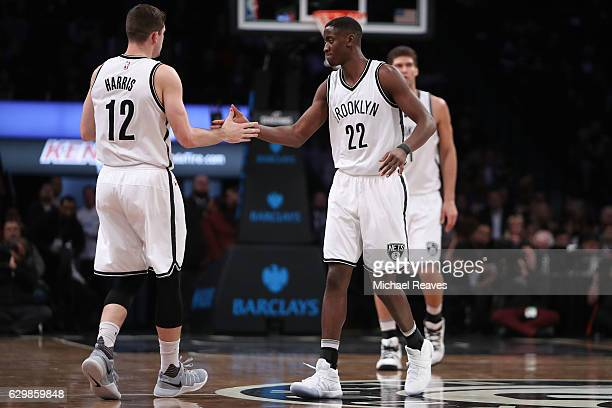 Caris LeVert of the Brooklyn Nets celebrates with Joe Harris against the Los Angeles Lakers in the first half at Barclays Center on December 14 2016...