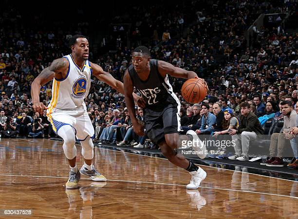 Caris LeVert of the Brooklyn Nets drives during a game against Andre Iguodala of the Golden State Warriors on December 22 2016 at Barclays Center in...