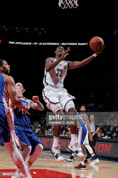 Caris LeVert of the Brooklyn Nets drives to the basket against the Philadelphia 76ers on October 11 2017 at Nassau Veterans Memorial Coliseum in...