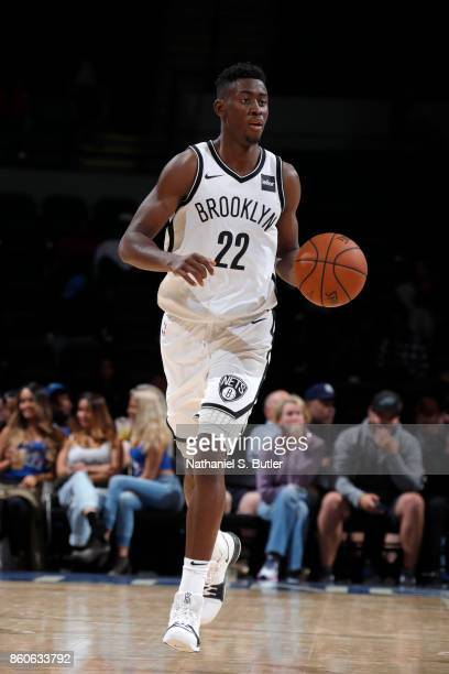 Caris LeVert of the Brooklyn Nets handles the ball against the Philadelphia 76ers on October 11 2017 at Nassau Veterans Memorial Coliseum in...