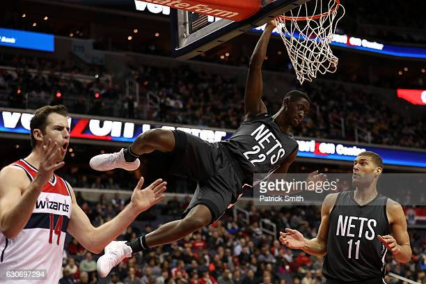 Caris LeVert of the Brooklyn Nets hangs from the rim after being fouled by Jason Smith of the Washington Wizards during the second half at Verizon...