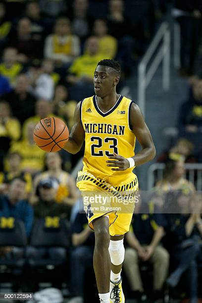 Caris LeVert of the Michigan Wolverines brings the ball up court against the Xavier Musketeers during the first half at Crisler Arena on November 20...