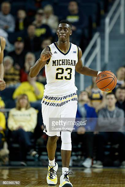 Caris LeVert of the Michigan Wolverines brings the ball up court against the Northern Kentucky Norse during the first half at Crisler Arena on...