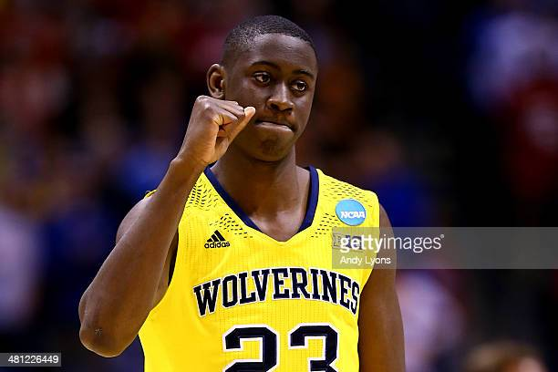 Caris LeVert of the Michigan Wolverines celebrates defeating the Tennessee Volunteers 73 to 71 during the regional semifinal of the 2014 NCAA Men's...