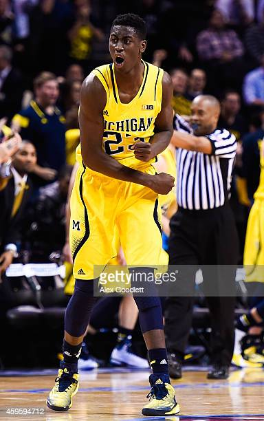 Caris LeVert of the Michigan Wolverines celebrates in the second half during a game against the Villanova Wildcats at the Barclays Center on November...