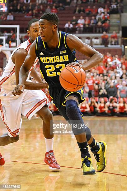 Caris LeVert of the Michigan Wolverines controls the ball against the Ohio State Buckeyes on January 13 2015 at Value City Arena in Columbus Ohio...