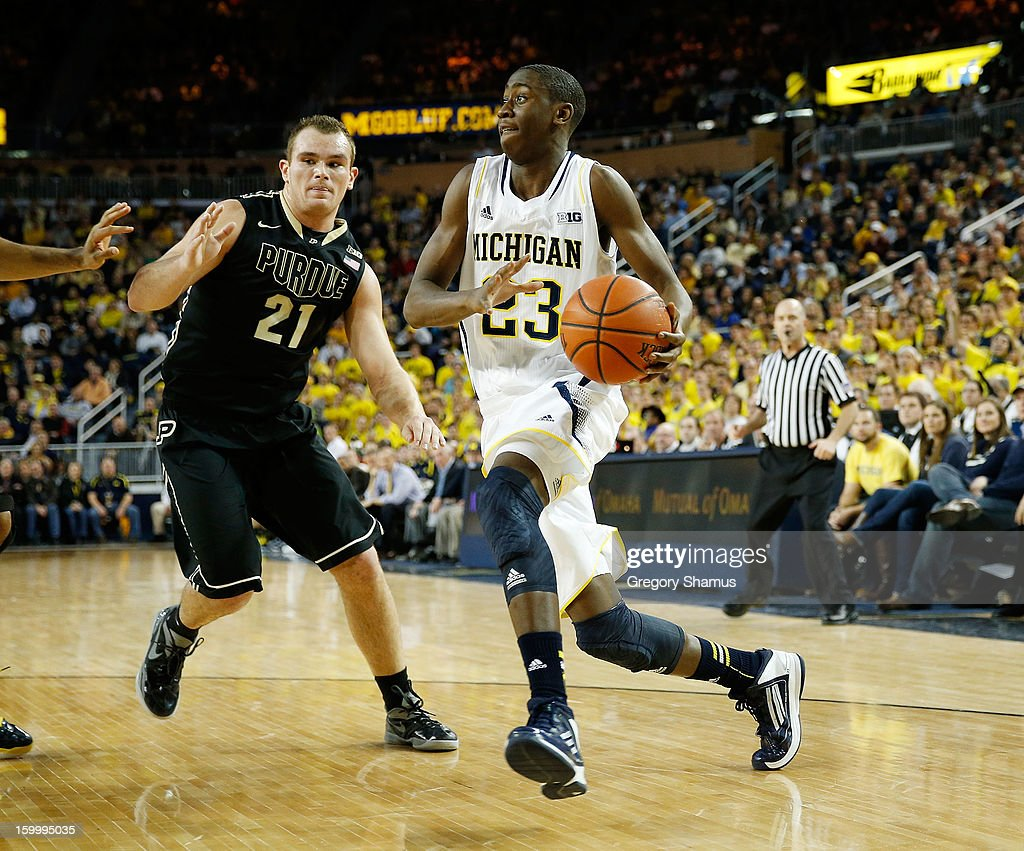 Caris LeVert #23 of the Michigan Wolverines drives around D.J. Byrd #21 of the Purdue Boilermakers during the first half at Crisler Center on January 24, 2013 in Ann Arbor, Michigan. Michigan won the game 68-53.