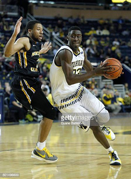 Caris LeVert of the Michigan Wolverines drives to the basket against Tyler White of the Northern Kentucky Norse during the first half at Crisler...