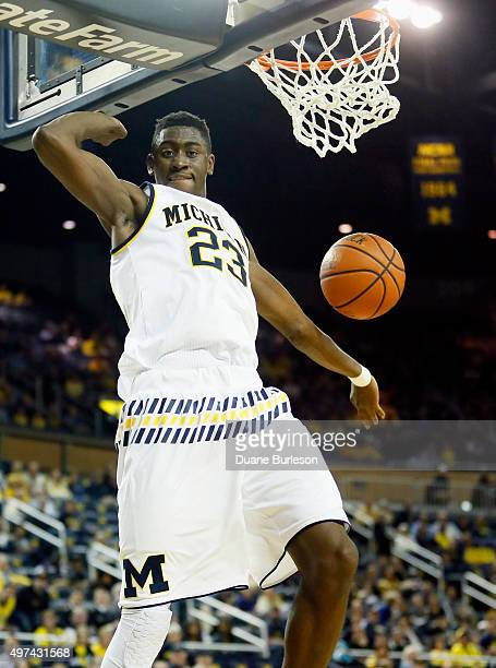 Caris LeVert of the Michigan Wolverines dunks against the Elon Phoenix during the first half at Crisler Arena on November 16 2015 in Ann Arbor...