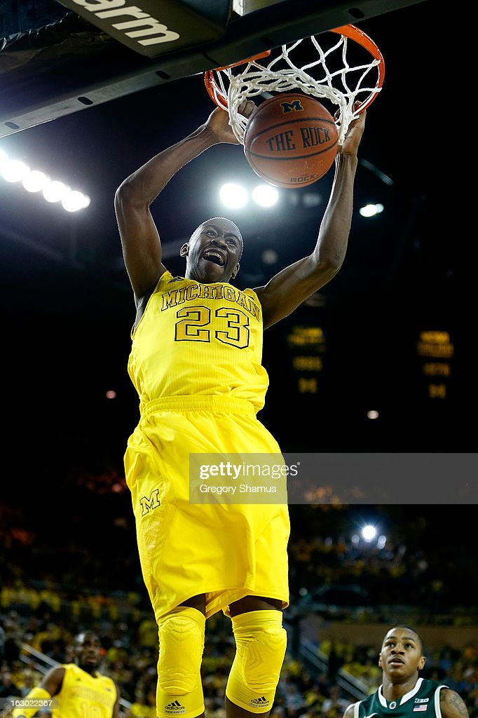 Caris LeVert #23 of the Michigan Wolverines gets in for a first half dunk while playing the Michigan State Spartans at Crisler Center on March 3, 2013 in Ann Arbor, Michigan.