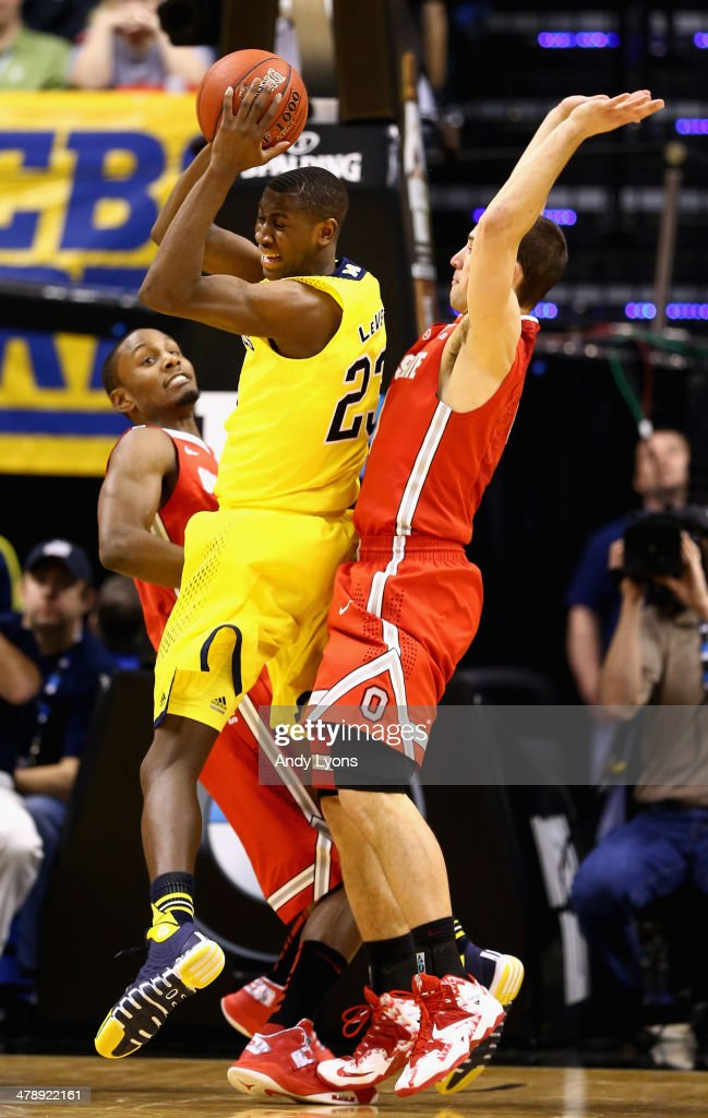Caris LeVert #23 of the Michigan Wolverines gets the rebound and are up by three points in the last few seconds of the Big Ten Basketball Tournament Semifinal game against the Ohio State Buckeyes at Bankers Life Fieldhouse on March 15, 2014 in Indianapolis, Indiana. Michigan defeated Ohio State 72-69.