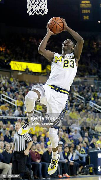 Caris LeVert of the Michigan Wolverines goes up to dunk against the Minnesota Golden Gophers during the first half at Crisler Arena on January 10...