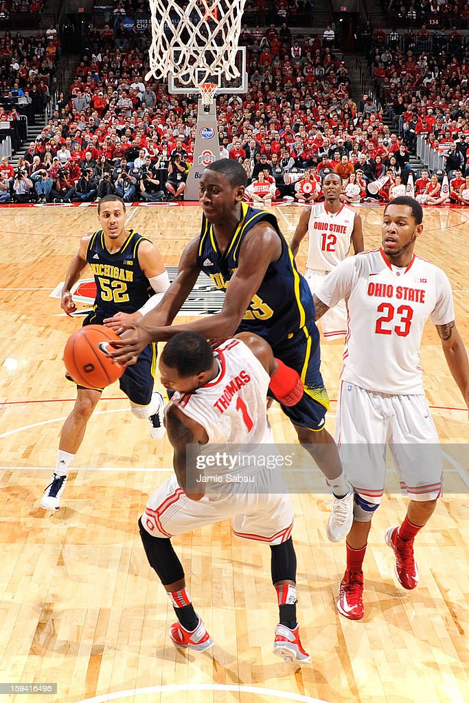 Caris LeVert #23 of the Michigan Wolverines is fouled by Deshaun Thomas #1 of the Ohio State Buckeyes while driving to the basket in the second half on January 13, 2013 at Value City Arena in Columbus, Ohio. Ohio State defeated Michigan 56-53.