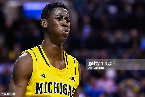 Caris LeVert of the Michigan Wolverines looks on during a game against the Villanova Wildcats at the Barclays Center on November 25 2014 in the...