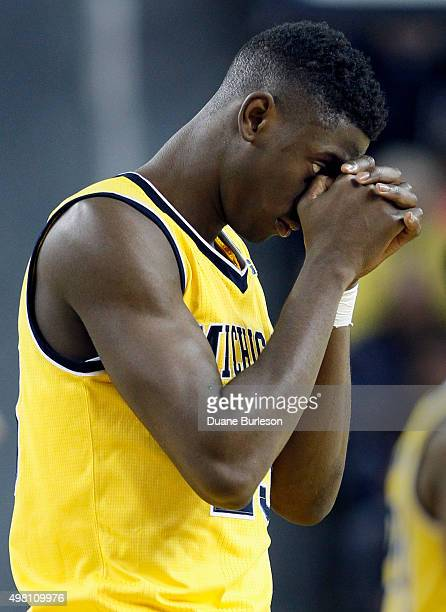 Caris LeVert of the Michigan Wolverines reacts after a scoring run by the Xavier Musketeers during the fourth quarter at Crisler Arena on November 20...