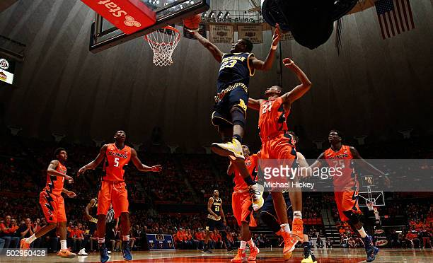 Caris LeVert of the Michigan Wolverines shoots the ball against the Illinois Fighting Illini at Memorial Stadium on December 30 2015 in Champaign...