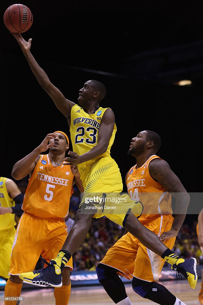 Caris LeVert #23 of the Michigan Wolverines shoots the ball in the first half against <a gi-track='captionPersonalityLinkClicked' href=/galleries/search?phrase=Jarnell+Stokes&family=editorial&specificpeople=8795785 ng-click='$event.stopPropagation()'>Jarnell Stokes</a> #5 and Jeronne Maymon #34 of the Tennessee Volunteers during the regional semifinal of the 2014 NCAA Men's Basketball Tournament at Lucas Oil Stadium on March 28, 2014 in Indianapolis, Indiana.