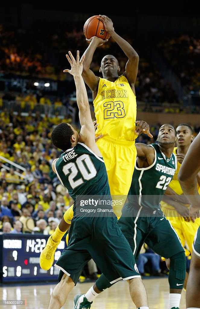 Caris LeVert #23 of the Michigan Wolverines takes a first half shot over Travis Trice #20 of the Michigan State Spartans at Crisler Center on March 3, 2013 in Ann Arbor, Michigan.