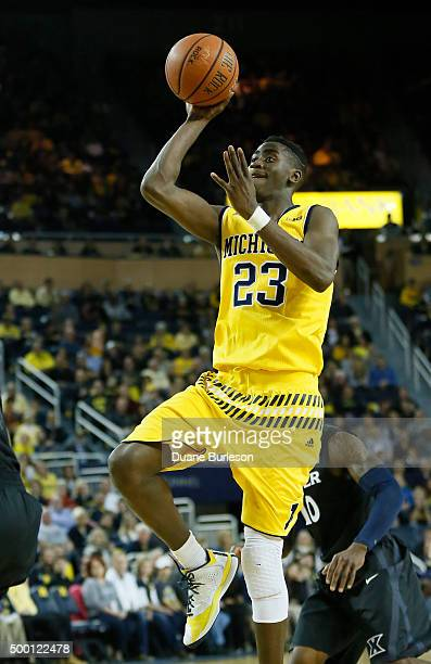 Caris LeVert of the Michigan Wolverines takes a shot against the Xavier Musketeers during the first half at Crisler Arena on November 20 2015 in Ann...