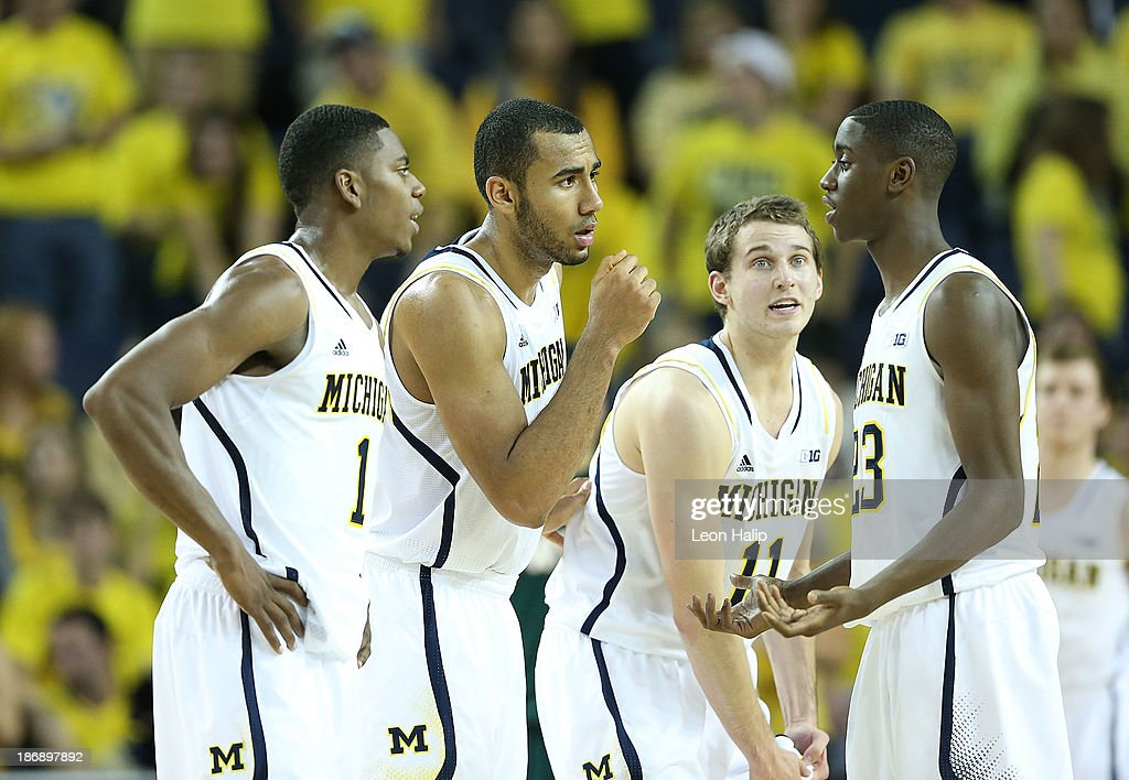 Caris LeVert #23 of the Michigan Wolverines talks with his teammates <a gi-track='captionPersonalityLinkClicked' href=/galleries/search?phrase=Glenn+Robinson+-+Basketball+Player+-+Born+1994&family=editorial&specificpeople=9920511 ng-click='$event.stopPropagation()'>Glenn Robinson</a> III, Jon Holford #15 and Nik Stauskas #11 during the game against the Wayne State Warriors at Crisler Center on November 4, 2013 in Ann Arbor, Michigan. Michigan defeated Wayne State 79-60.