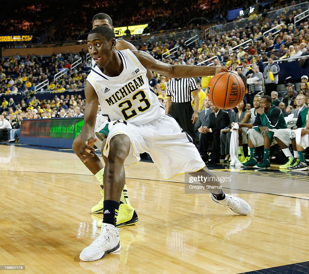 Caris LeVert #23 of the Michigan Wolverines tries to drive to the basket during the first half while playing the Eastern Michigan Eagles at Crisler Center on December 20, 2012 in Ann Arbor, Michigan.