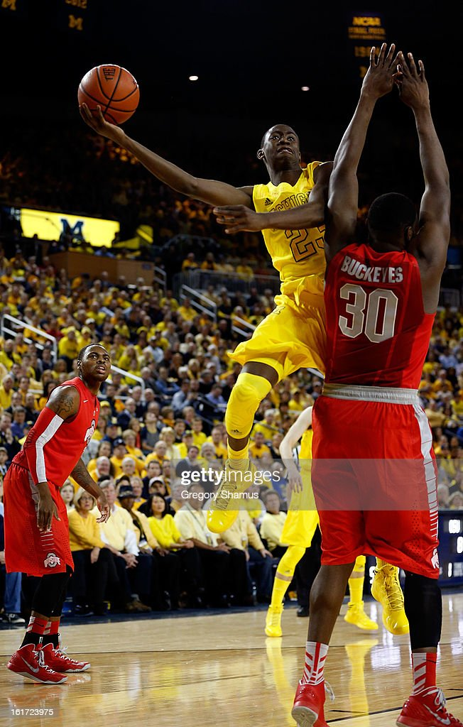 Caris LeVert #23 of the Michigan Wolverines tries to get a shot off over Evan Ravenel #30 of the Ohio State Buckeyes at Crisler Center on February 5, 2013 in Ann Arbor, Michigan.