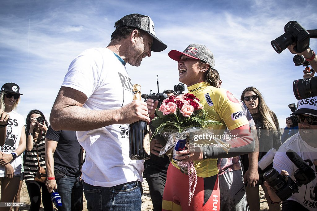 Carissa Moore and father from Hawaii celebrate taking the win and the world title at EDP Girls Pro on October 5, 2013 in Cascais, Portugal.