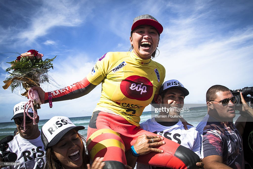 Carissa Moore from Hawaii celebrates taking the win and the world title at EDP Girls Pro on October 5, 2013 in Cascais, Portugal.
