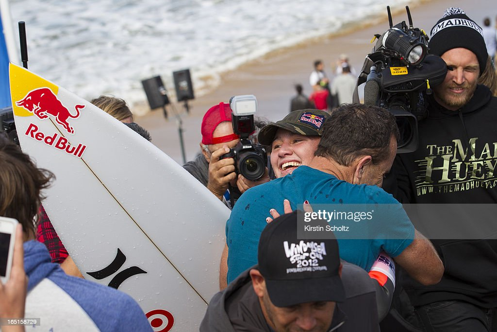 Carissa Moore of Hawaii hugs her dad Chris Moore after winning the Rip Curl Pro Bells Beach on April 1, 2013 in Bells Beach, Australia.