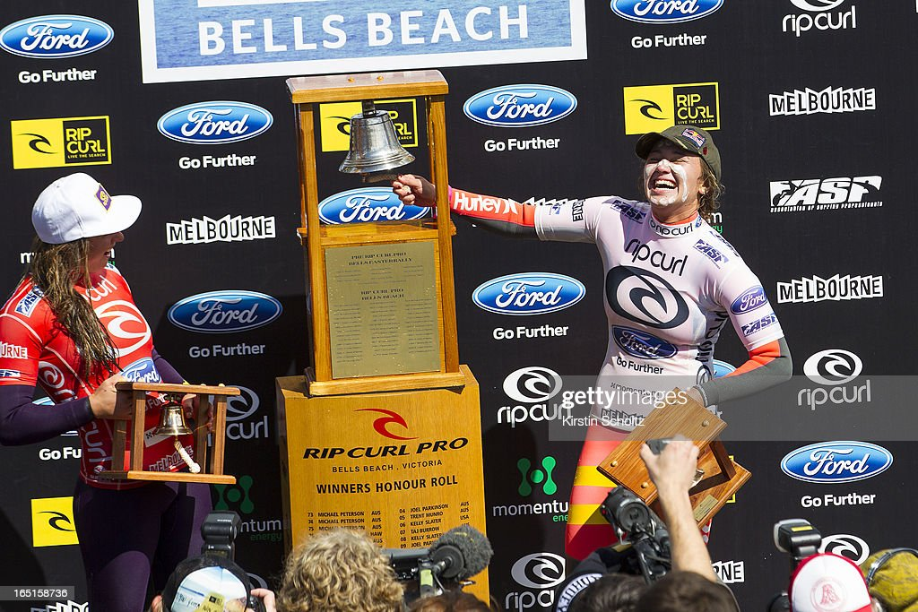 Carissa Moore (R) of Hawaii rings the bell after winning the Rip Curl Pro Bells Beach over Tyler Wright (L) during prizegiving on April 1, 2013 in Bells Beach, Australia.