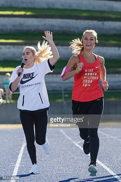 Carissa Walford cheers on Anna Heinrich at the finish of the Nike Women's Half Marathon at Sydney Olympic Park on July 3 2016 in Sydney Australia