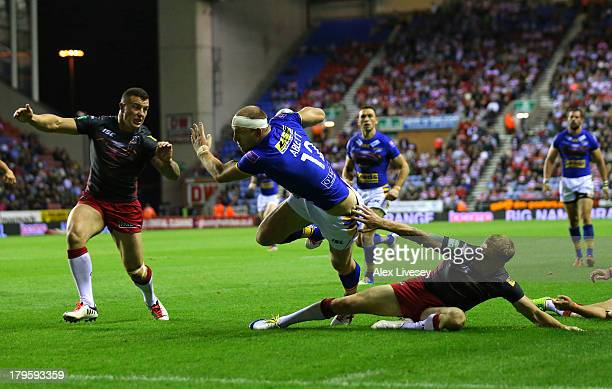 Carl Ablett of Leeds Rhinos dives over the line to score a try during the Super League match between Wigan Warriors and Leeds Rhinos at DW Stadium on...