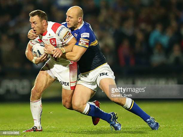 Carl Ablett of Leeds Rhinos tackles James Roby of St Helens RFC during the First Utility Super League Semi Final between Leeds Rhinos and St Helens...